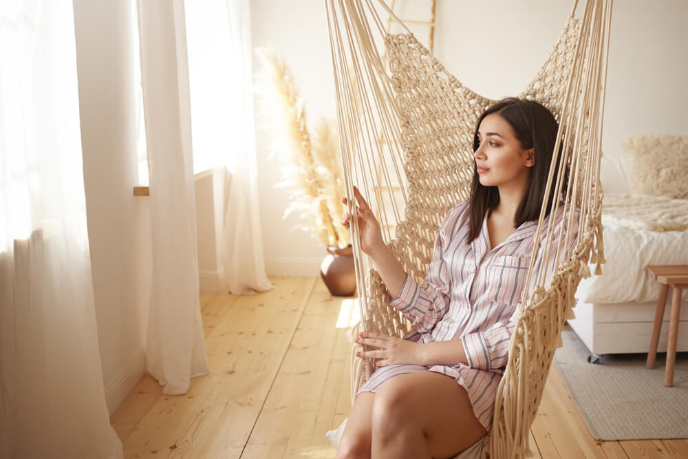 Model sitting in hammock