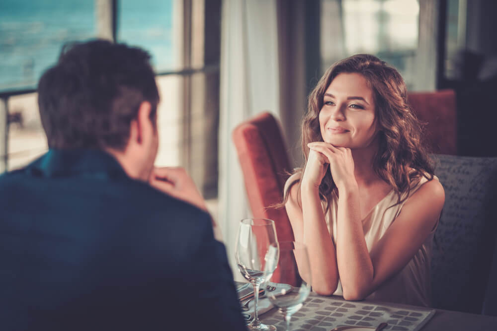 man and woman in a restaurant for first dinner date