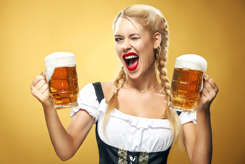Blonde model holding two beer steins