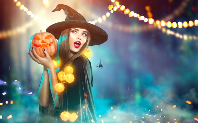 Model holding pumpkin